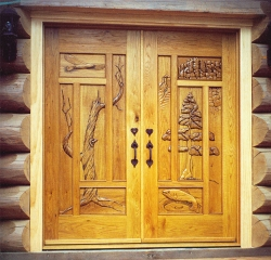 The local landscape is reflected in the carved images on this set of doors.